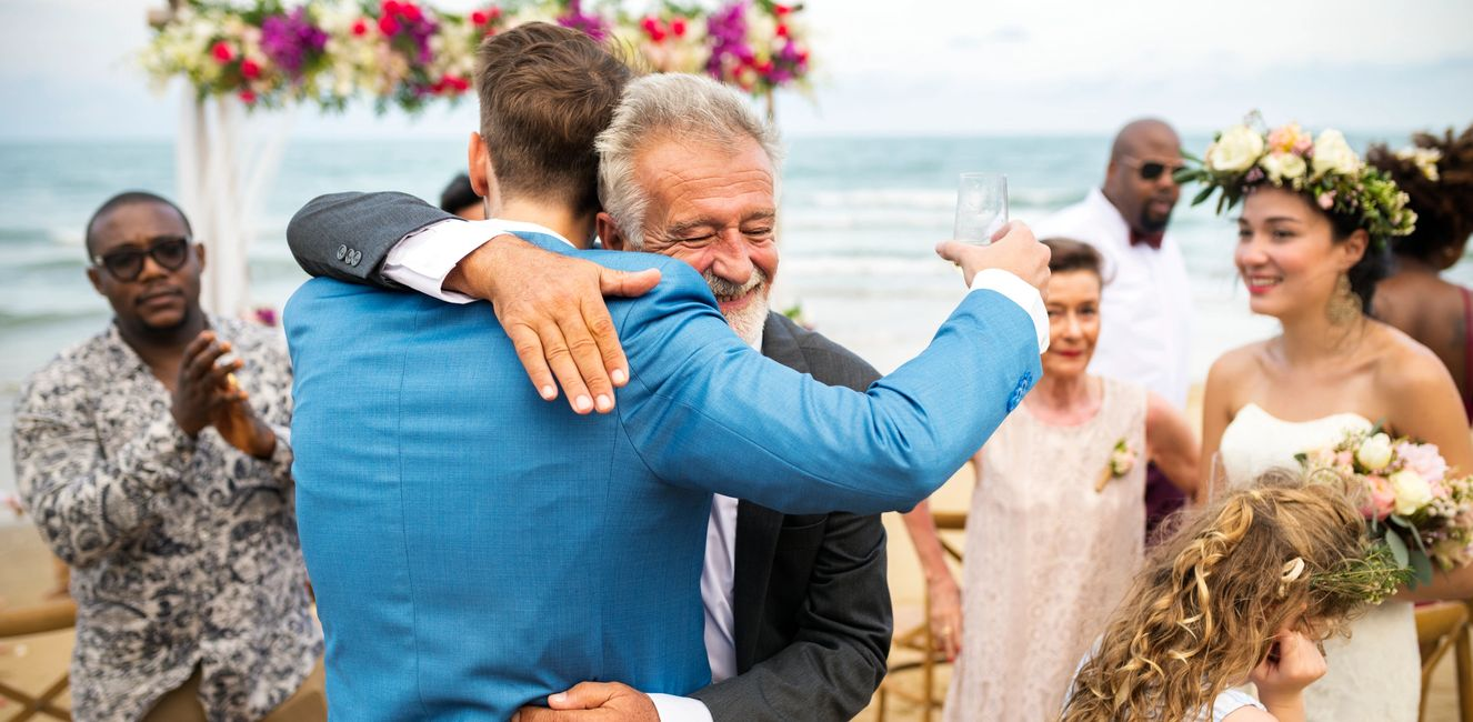 father and son hugging on son's wedding day