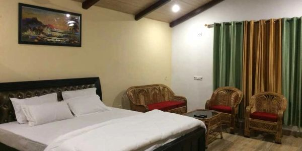 Deluxe Cottage with private lawn at Balaut Resort near Nainital