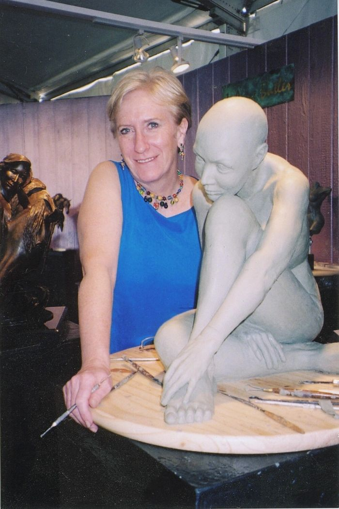 Nude, female, figurative sculpture at the sculpting stage with bronze artist, J. Anne Butler