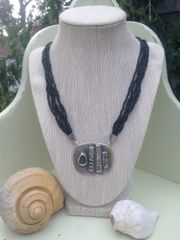 Fine Silver Focal Pendant with Patina on Multi-Strand Black Beaded Necklace
