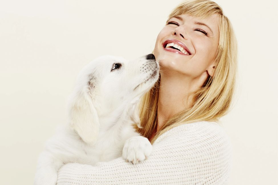Joyful woman with puppy