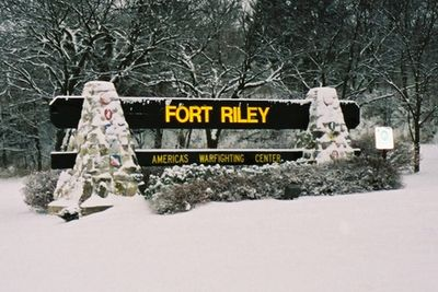 Fort Riley sign at gate. Photo is from winter and there is snow all around.