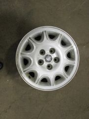 SET OF EARLY MODEL ALUMINUM JAGUAR WHEELS