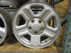 SET OF STEEL LATE MODEL JEEP WRANGLER WHEELS