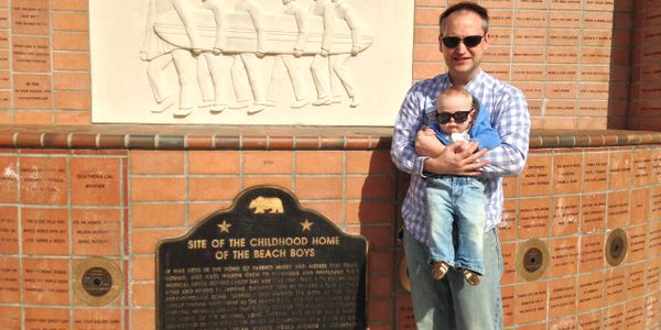 At the commemorative monument at the site of the childhood home of the Beach Boys.
