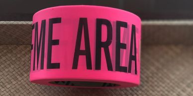 "Tape, Pink with Black Print to read FME AREA, 3"" Wide X 1000 Feet"