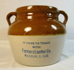 Vintage Farmers Lumber Co. Madison, S. Dak advertising crock #213