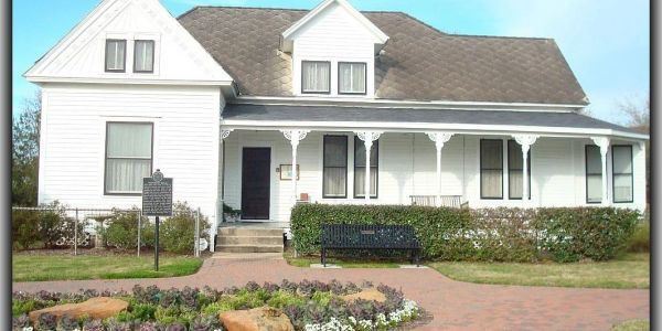 The Stockdick House. A historical home at Johnny Nelson Katy Heritage Museum showing the freshly painted white exterior.