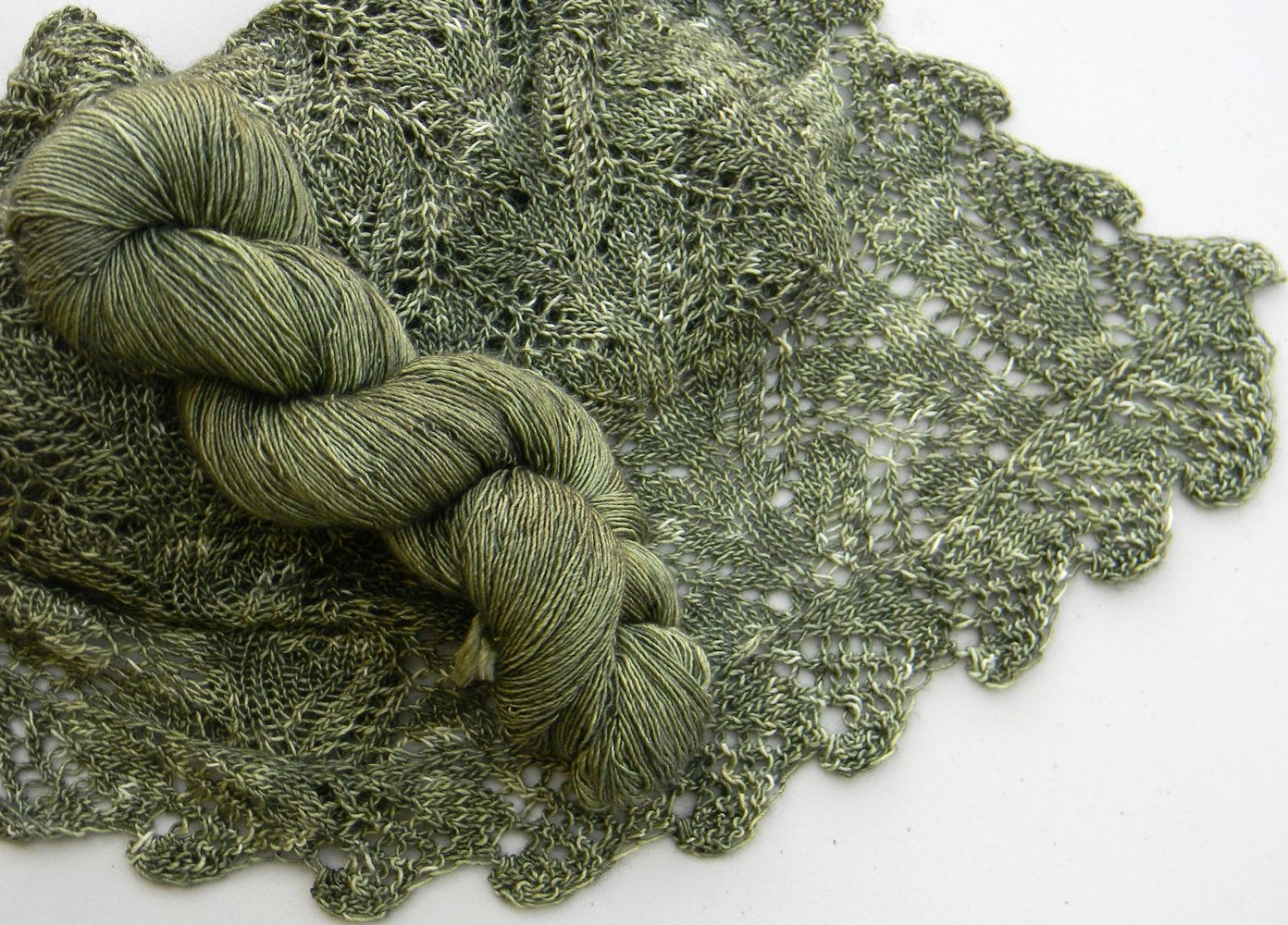 Ferndale Shawl - lace with knitted on lace edging shown in Old Money colorway on Twist Monkey base.