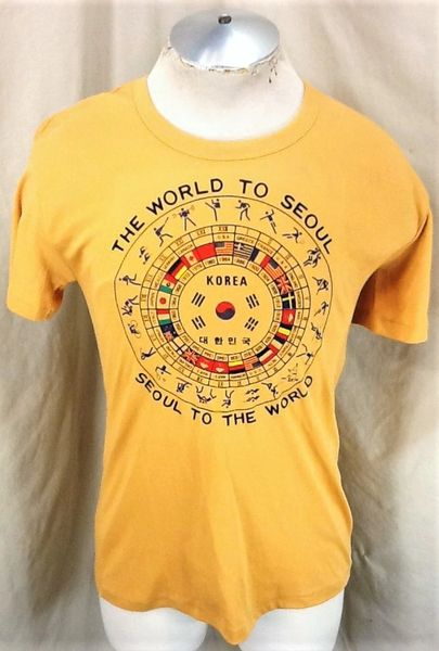 "Vintage 1984 Seoul Olympics (Medium) Retro ""Olympic Timeline"" Graphic T-Shirt"