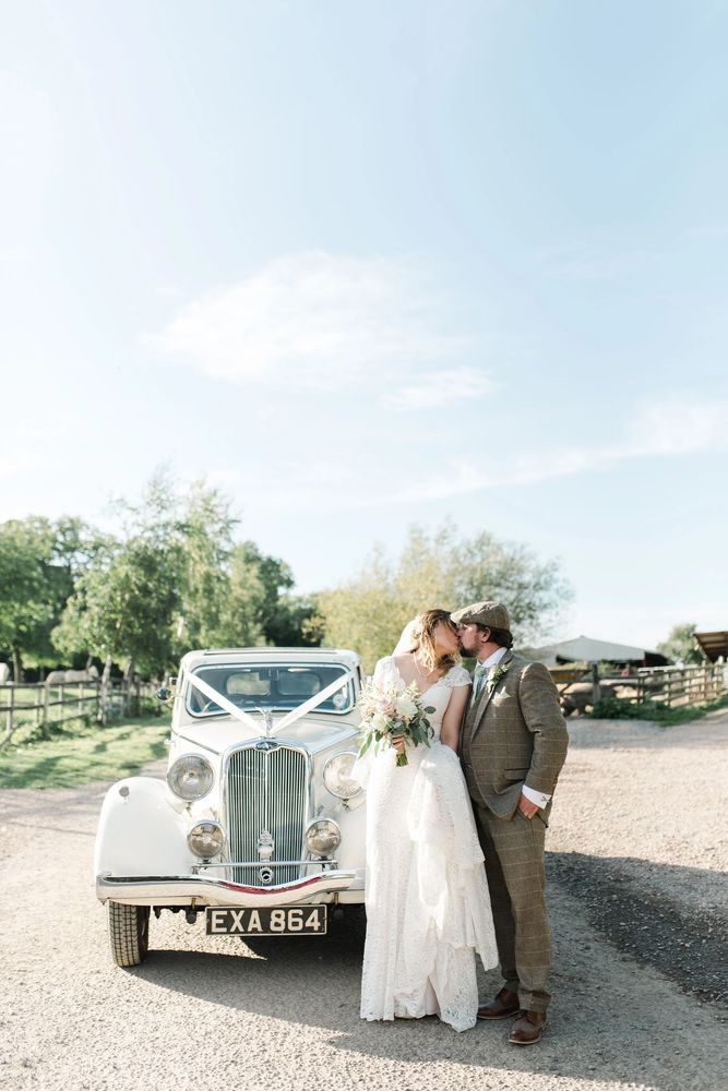 Married couple at Milton End with vintage wedding Hire