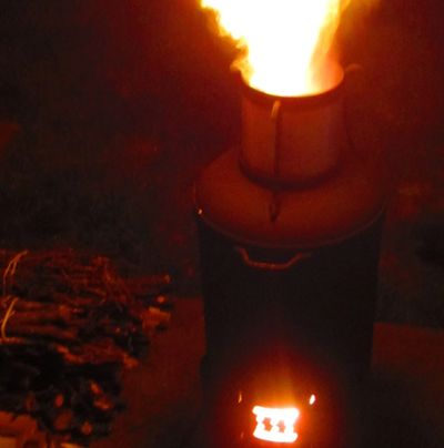 PAC Torch early version. Set up on patio slab. Bundled wood fuel.