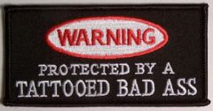 WARNING PROTECTED BY A TATTOOED BAD ASS