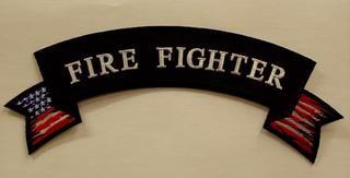 FIRE FIGHTER W/ AMERICAN FLAG (ROCKER)