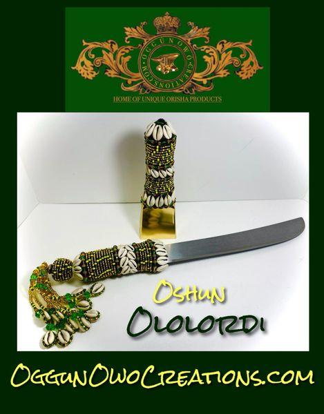 Machete and cencerro (cowbell)For Oshun Ololordi