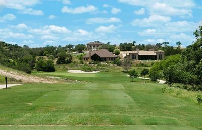 Comanche Trace clubhouse and golf course view