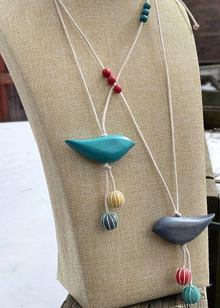 Caracol Bird Necklaces