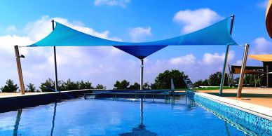 Protective shade sail covering a pool in Peyia, Paphos, Cyprus.