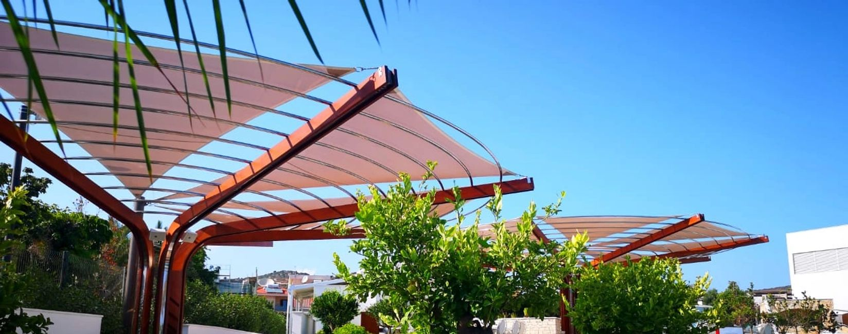 Shade canopy construction covered with shade cloth for sun shade at a hotel in Cyprus.