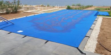 a pool cover providing shade and protection by Shadeports Plus.