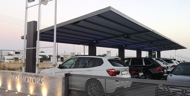A carport or car canopy for multiple vehicles in Cyprus.