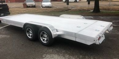 Aluminum car hauler trailer with a solid floor