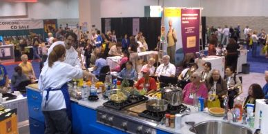 Chef Marti and Stormy Mongiello cooking liv on stage in front of 100,000 visitors.
