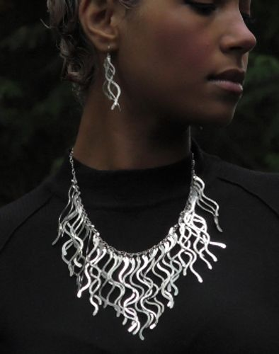 Sculptural necklace by  Manya Vee Jewelry.