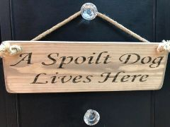 A Spoilt Dog Lives Here Sign