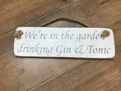 'We're in the Garden Drinking Gin & Tonic' Sign by Austin Sloan