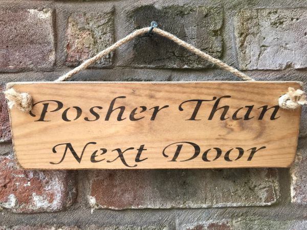 Posher Than Next Door Sign