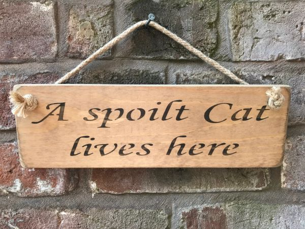 A Spoilt Cat Lives Here Sign