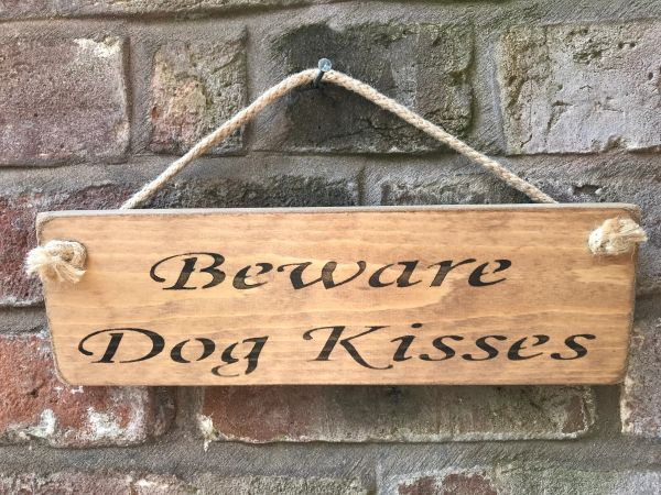 Beware Dog Kisses Sign