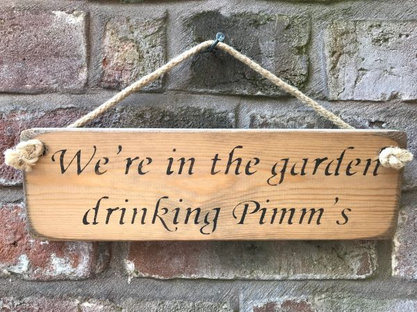 We're in the garden drinking Pimm's Sign