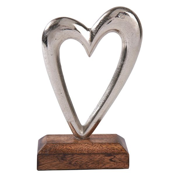 Silver metal heart on wooden base