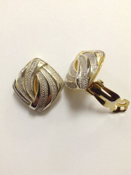 Silvertone and Goldtone Swirl Clip on Earrings