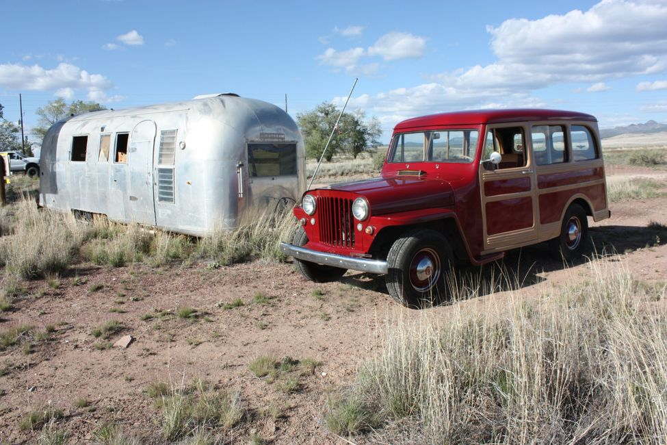 Route 66 trip. 1946 Willys Wagon and vintage Airstream trailer on historic Route 66 Seligman, Arizon