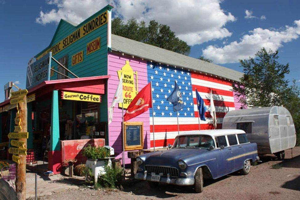 Restoration of the Seligman Sundries in video. !946 Invade trailer and 1955 Chevy and American Flag