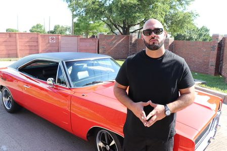 Rapper Motian on the set of The Journey Music video featuring a 1968 Dodge Charger R/T 440 Magnum