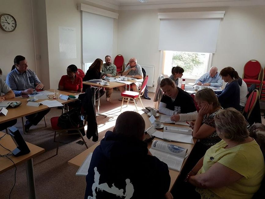 People taking part in a mental health first aid training course.