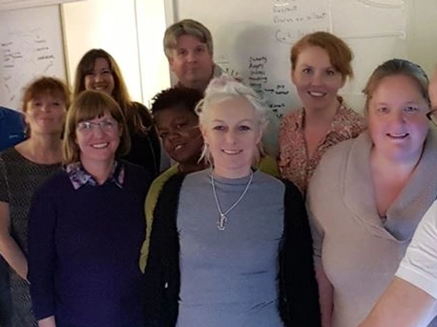 People taking part in a mental health first aid training course with MHFA999 LTD.