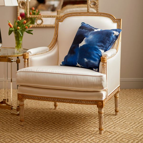 LOUIS XVI STYLE CARVED BEECHWOOD ARMCHAIR WITH DISTRESSED WHITE FINISH