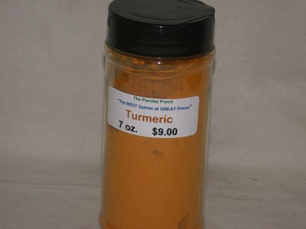 Turmeric, 7 oz., in a large shaker