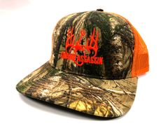 New Swamp Assassin Realtree Extra and Neon Orange Logo Snapback