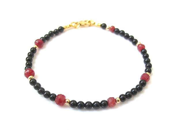 14 k gold black onyx and red ruby gemstone bracelet