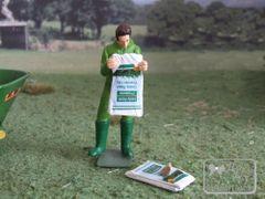 WM078E Man Emptying Sack of Grass Seed