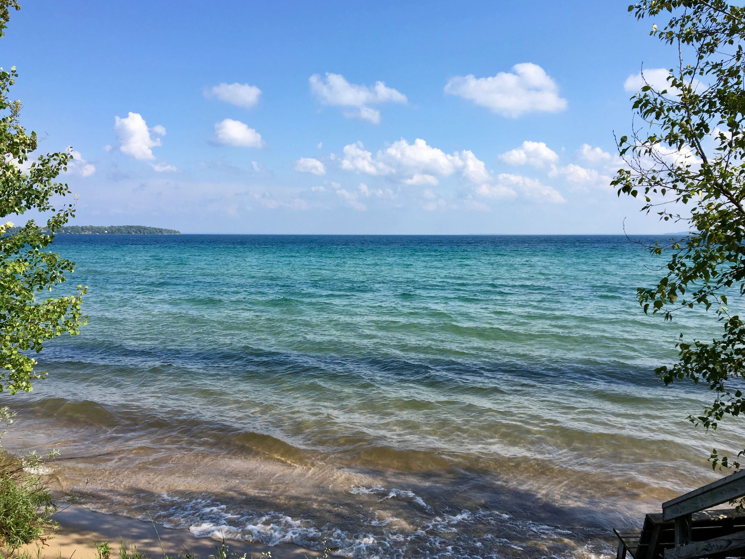 Grand Traverse Bay, Lake Michigan, a source of inspiration for our car window decals, hats, shirts.