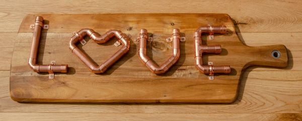 Copper pipe love sign