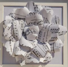 White sheet music rose