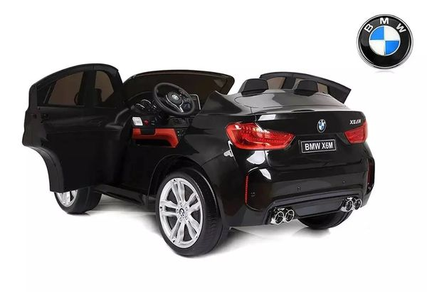 Licensed BMW two seater XM6 with Remote Control over ride Aux wire connection leather seat and full rubber tires MATT BLACK